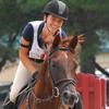 Pony club member riding her pony.