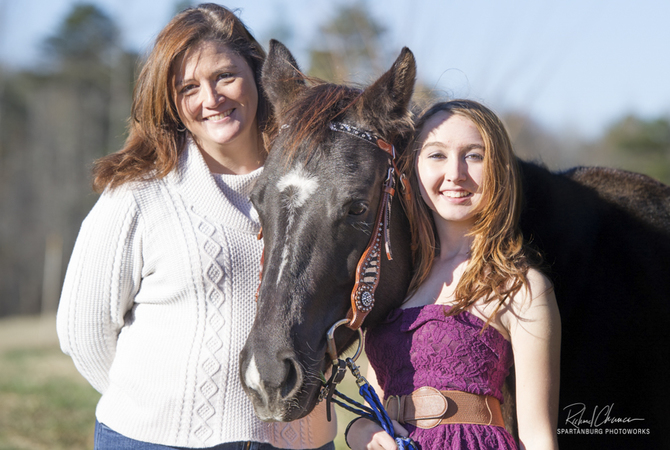 Pamela Miller of NetPosse with daughter and horse.
