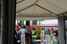 A horse being led into a temporary quarantine facility.