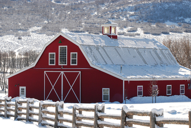 Red horse barn in snowy winter scene