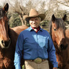 Monty Roberts with two mustangs he 'gentled'.