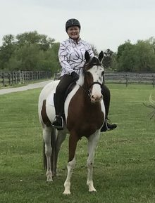 Sheryl Kerr on her horse at her equine facility.