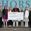 Veterinarian students receiving Merck scholarship checks.