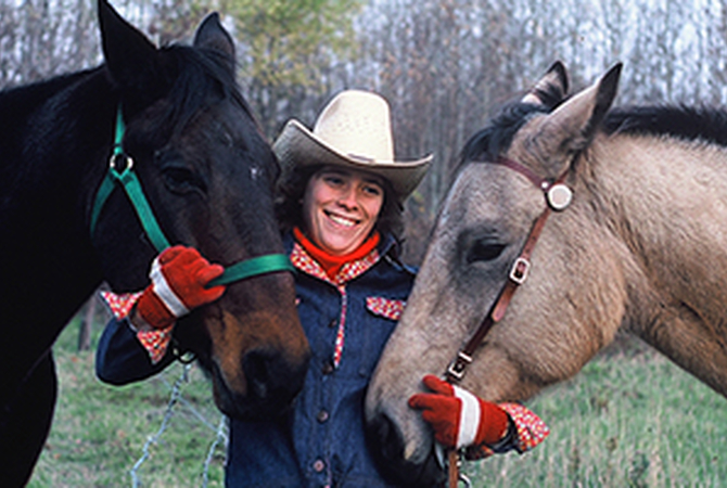 Melissa Chapman with two horses.