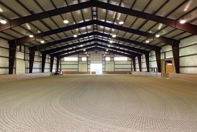 ArenaGreen footing in an indoor horse arena.