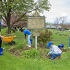 Student volunteers working to clean and spruce up local African cemetery.
