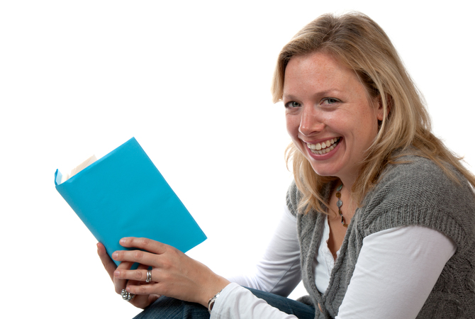 Woman enjoying reading a book.