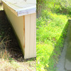 Before and after photos showing how installation of a French drain improves drainage.