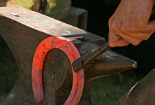 Farrier crafting a custom horse shoe